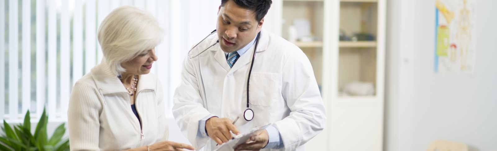 Doctor and patient reviewing chart information